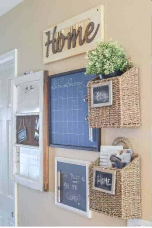Classic Farmhouse Styled Family Command Center Add a touch of organization to your farmhouse decor with this classic family command center idea. The chalkboards and baskets not only are perfect to stay organized but are also very visually appealing to the eye.