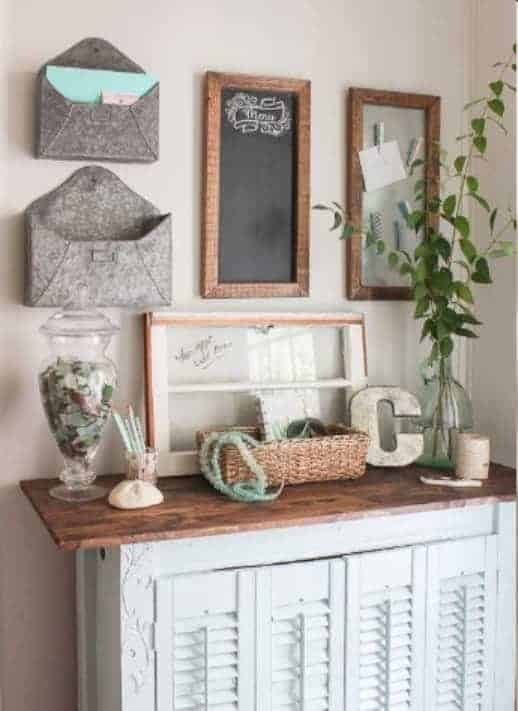 Vintage Styled Command Center If you love vintage style, then this family command center is right up your alley. Use an antique desk or vanity and add a few subtle farmhouse styled pieces and you have a beautiful place to get and stay organized.