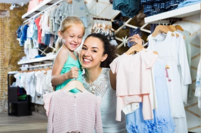 Mom & Child clothes Shopping at a thrift store to never pay full price on clothes