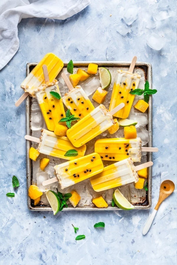 Coconut Macadamia Passion Fruit Mango Popsicles