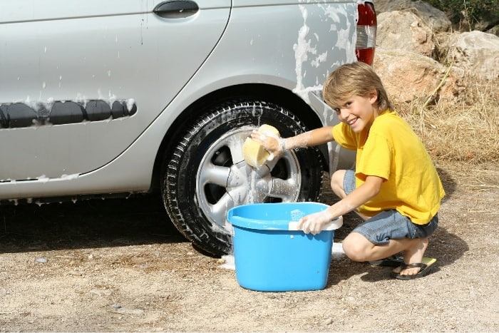 Kid washing cars for money