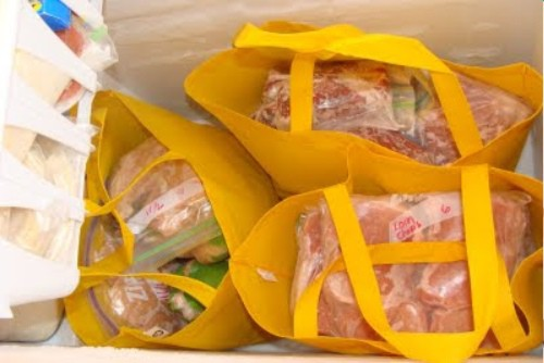 Use recycable grocery bags to organize a chest freezer