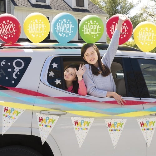 Car decorated for a drive by birthday parade