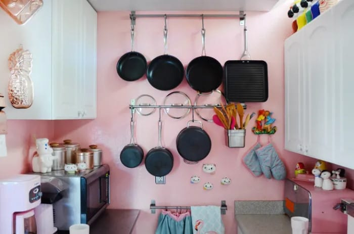 Use pot rails to hang pots and pans